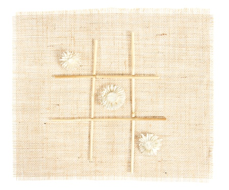 tic tac toe: Sackcloth with Tic Tac Toe game pattern with straws on burlap  Stock Photo