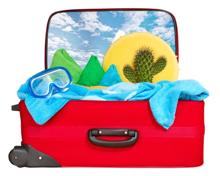 Travel red suitcase. Packed for summer vacation in sea resort. Tropical beach. Isolated on white photo