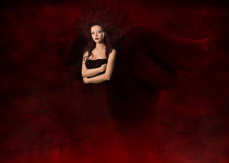 demon: Dark angel. Beautiful gothic style woman with wings standing in red fog cemetery at black night