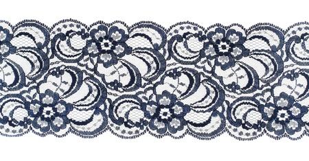 veters: Kantversiering lint over wit. Geborduurde stof. Close-up Stockfoto