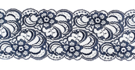 Lace trim ribbon over white. Embroidered fabric. Closeup photo
