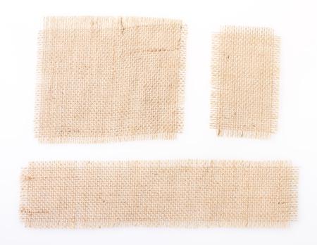 sackcloth tags set of three piece over white. burlap. canvas photo