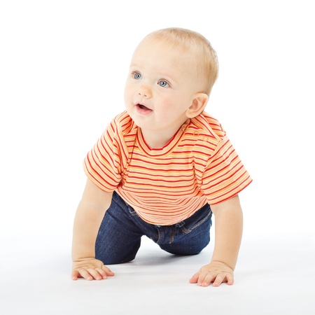 active one year baby crawling over white background photo