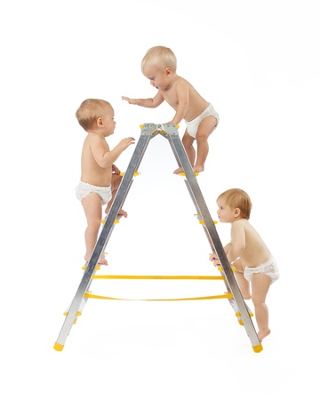 group of babies climbing on stepladder over white background