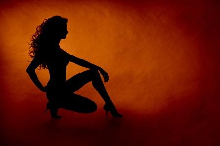 woman sexy silhouette over orange background Stock Photo - 12033029