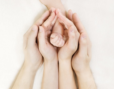 Parent's hands holding baby's hand Stock Photo - 12033028