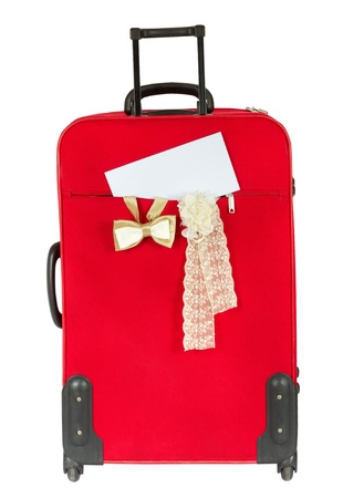 Suitcase with blank white envelop. Vertical. Over white photo