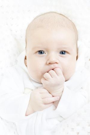 newborn baby closeup portrait over white soft background. Indigo eyes looking at camera Stock Photo - 12374462