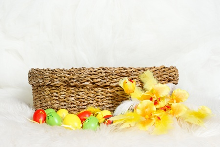 Empty Easter basket with multicolor Easter eggs and flower. Copy space Stock Photo - 12679255