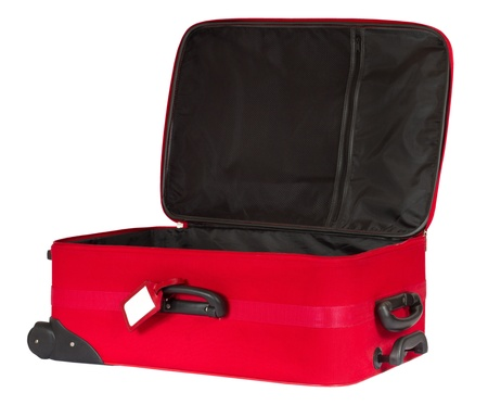 Open red suitcase with blank identification tag isolated over white. photo