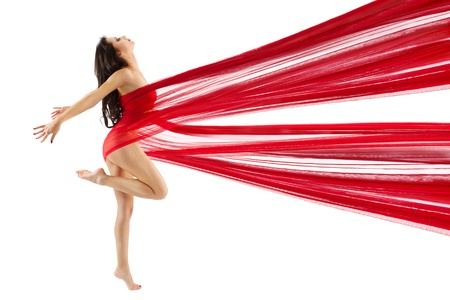 acrobat: Woman dancing with red flying waving chiffon cloth. Dancer with perfect body shape. Isolated.