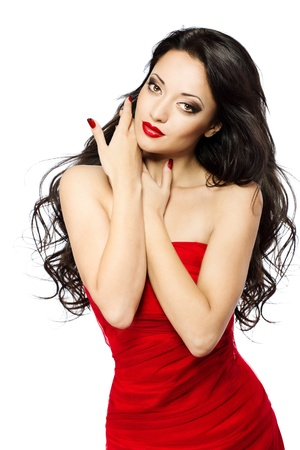 sensual lips: Beautiful woman portrait with red lips, long curly hairs in red dress over white background Stock Photo