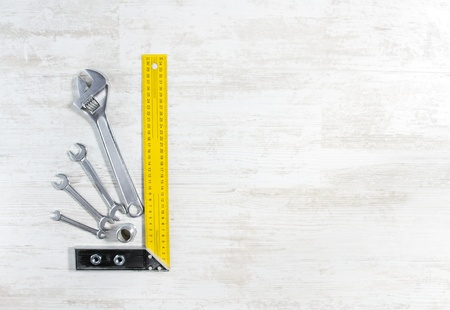Wrench tools set for construction work over wooden background. Stock Photo - 13994182