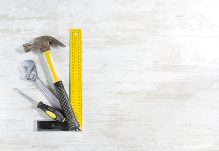 Tools set for construction work over wooden background. photo