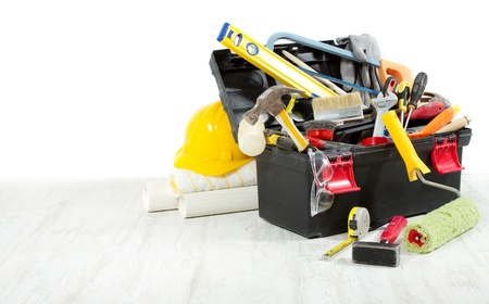 paint box: Tools in toolbox over wooden floor against empty wall. Copy space. Stock Photo