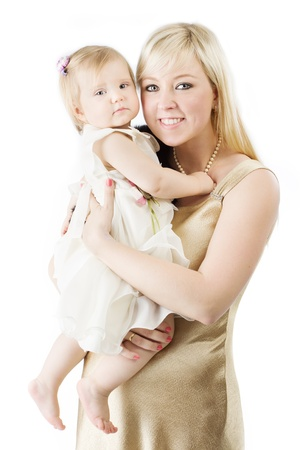Happy mother holding smiling one year daughter over white photo