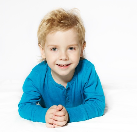 Smiling child lying down, looking at camera Stock Photo - 14312472
