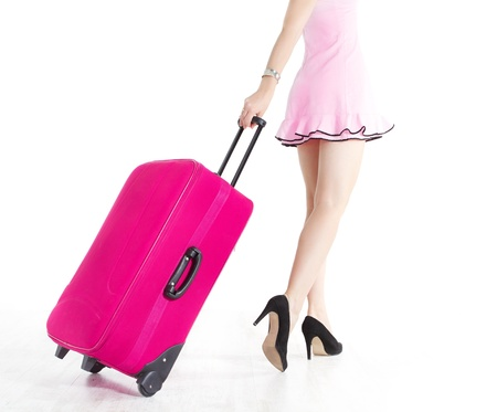 Woman legs going and pulling vacation suitcase photo