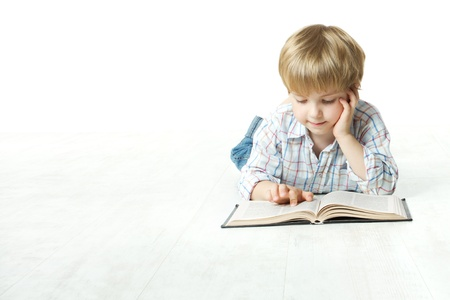 Reading book little child lying down on floor photo