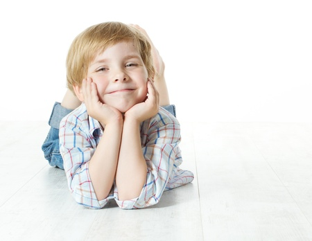 Smiling child lying down, looking at camera Stock Photo - 14772713