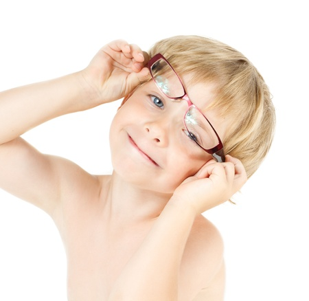 Child smiling in eyeglasses. Close up funny portrait photo