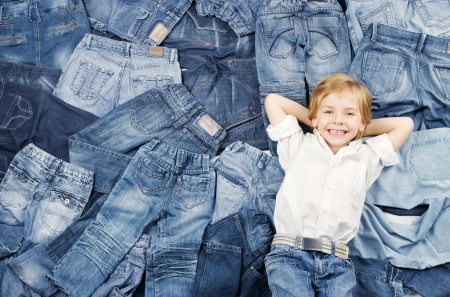 Happy child on jeans background  Denim fashion Stock Photo - 16057443