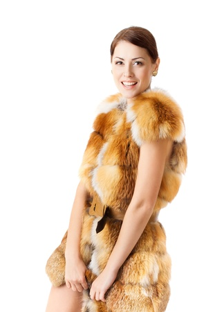 Fur fashion  Woman in winter coat over white photo