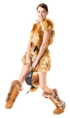 Fur mode vrouw jas, hoed en laarzen over wit