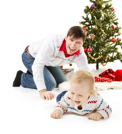 Christmas family and fir tree, smiling happy parents enjoy with child photo