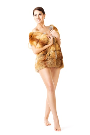 Fur fashion woman in coat, barefoot over white photo