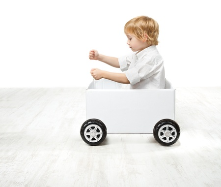 Child driving box car. Creativity and innovation concept photo