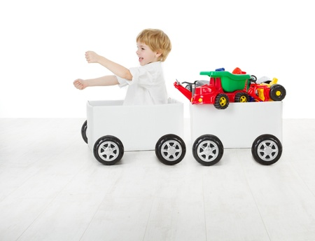carriages: Child driving box car and wagon with toys. Delivery and shipping concept