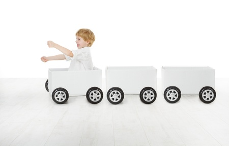 Child driving box car and empty wagons. Delivery and shipping concept photo
