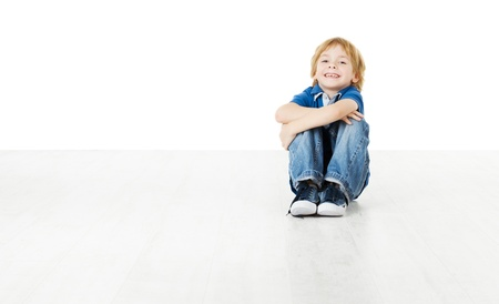 kid sitting: Smiling child sitting and looking at camera Stock Photo