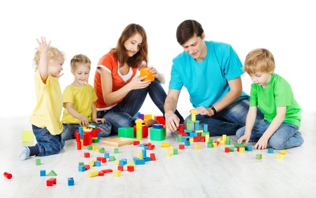 connection block: Happy family. Parents with three kids playing blocks over white