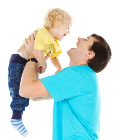 Happy father playing with  child raising him up over white Stock Photo - 16660424