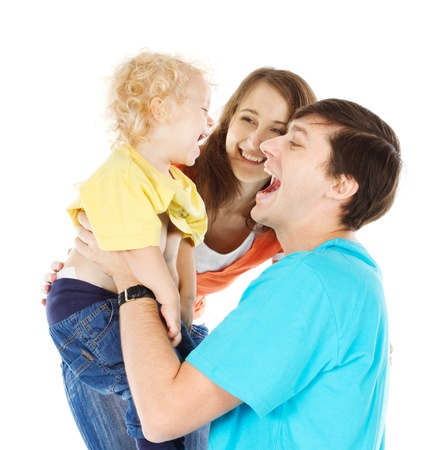 Happy family playing with child raising him up over white Stock Photo - 16660427