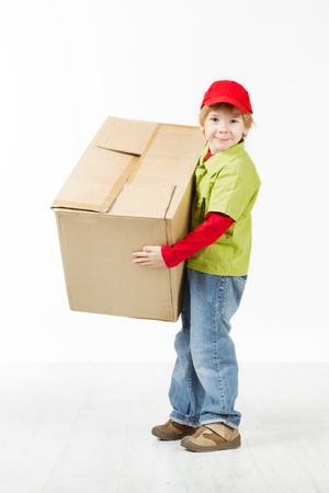 Boy holding big carton box. White background Stock Photo - 16660425
