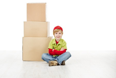 Boy sitting in front of carton boxes pyramid. Packing up to move. Growth concept. Stock Photo - 16660422