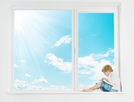 window light: Window sunshine sky. Child on windowsill reading book.