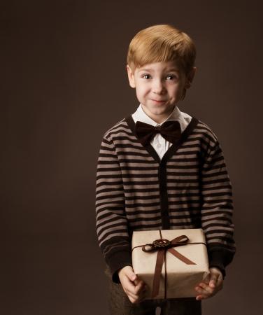 Child holding gift box  Vintage style  Stock Photo - 17515617