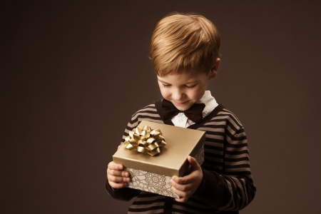 Child holding gift box  Vintage style  Stock Photo - 17515621