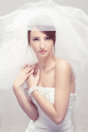 Bride in white veil looking at camera. Portrait. Fashion wedding shot. Stock Photo - 17515610