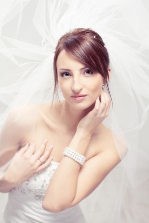 Bride in white veil looking at camera. Portrait. Fashion wedding shot. Stock Photo - 17515584
