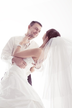 Wedding couple happy smiling and dancing. Groom portrait. Over white photo