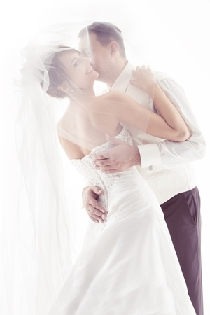 Wedding couple kissing and happy smiling. Bride portrait. Over white photo