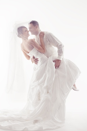 Wedding couple dancing and happy smiling. Bride and groom portrait. Over white photo