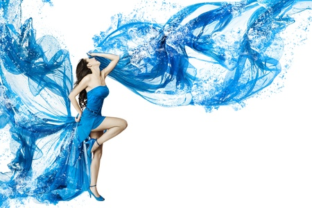 Woman dance in blue water dress dissolving in splash. Isolated white. photo