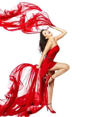 Woman  in red dress dancing with fabric flying on a wind flow. White Isolated photo