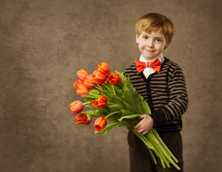 Child holding flowers bouquet. Vintage style. photo